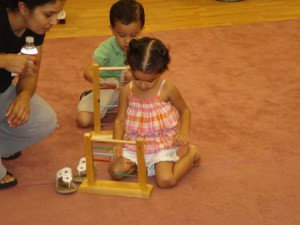 cute little girl playing the abacus
